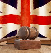 Wooden gavel and vintage England flag
