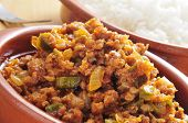 closeup of a earthenware plate with picadillo, a traditional dish in many latin american countries,