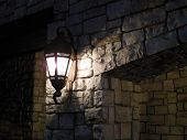 Lamp On A Rock Wall