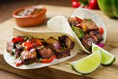 stock photo of lime  - Beef fajitas with peppers - JPG