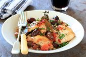 Chicken stew or cacciatore, with red wine.