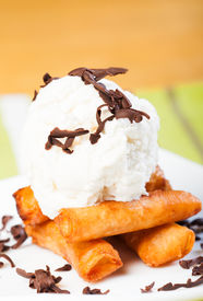 picture of lumpia  - fried custard wrapped lumpia wrapper topped with vanilla ice cream and shaved truffle chocolates - JPG