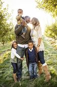 stock photo of orchard  - Beautiful Multi Ethnic Family Portrait Outdoors - JPG