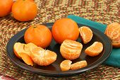 Clementines On A Dark Plate
