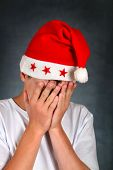 Sad Teenager In Santas Hat