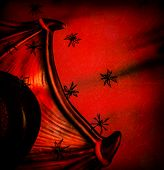 Halloween festive background, abstract dark red backdrop, many creepy spiders on Dracula collar, tall hat, post card, horror and evil concept