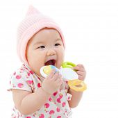 foto of teething baby  - Beautiful mixed race Asian baby girl teething - JPG
