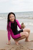 Girl Playing Sand On Sea Beach