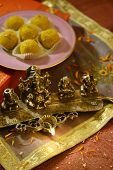 foto of laddu  - An box of Indian sweet and a traditional lamp - JPG