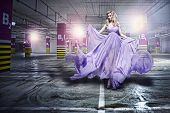 picture of flowing hair  - Fantastic fashion young woman in fluttering dress - JPG