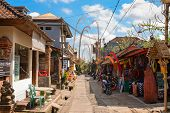Tourist Street Decorated By Traditional Penjor On Bali