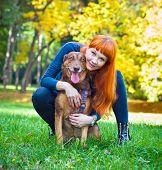 Elegant woman has fun with her big dog in the park in Novi Sad, Serbia.