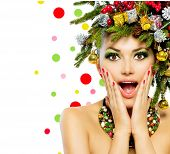 Christmas Woman. Beautiful New Year and Christmas Tree Holiday Hairstyle and Make up. Beauty Girl with Colorful Makeup, Hair, Nail polish and Accessories. Surprised Woman. Open Mouth, Emotions