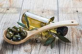 Olive Oil Bottle And A Spoon With Olives