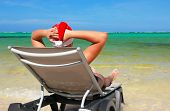 Santa Rest On Chaise Longue On Tropical Beach