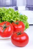 Tomatoes And Salad Leaf And Kitchen Processor