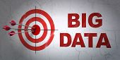 Data concept: target and Big Data on wall background
