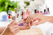 Close up of process of manicure at beauty salon