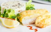 Fish fillet baked with cheese  and risotto with mushrooms