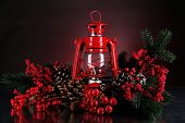 foto of kerosene lamp  - Red kerosene lamp on dark color background - JPG