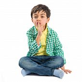 picture of silence  - Kid doing silence gesture over white background - JPG
