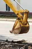 wheel excavator digging trench on rocky land