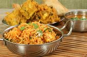 image of biryani  - indian food dish of panir biryani with biryani sauce - JPG
