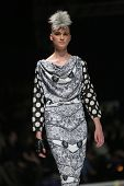 Fashion model wearing clothes designed by Zoran Aragovic on the 'Fashion.hr' show on March 28, 2014 in Zagreb, Croatia.