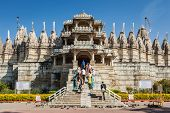 RANAKPUR, INDIA - NOVEMBER 25, 2012: Tourists and worshippers visit Jain temple in Ranakpur, Rajasth