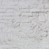 Old white plaster wall for background