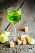 picture of absinthe  - Glass of absinthe with lime and sugar cubes