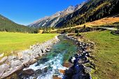 National Park Krimml Waterfalls in Austria. Headwaters of waterfalls - a narrow fast roiling river a