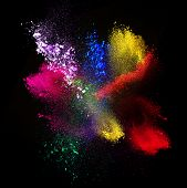 Colorful powders,  on black background
