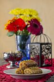 stock photo of baklava  - Baklava on a Table with Nuts and Flowers - JPG