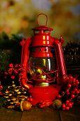 Red kerosene lamp on dark natural background