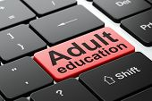 Education concept: Adult Education on computer keyboard
