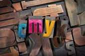 cmyk written with colored vintage letterpress printing blocks on random letters background