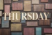 image of thursday  - Wooden letters forming word THURSDAY written on wooden background - JPG