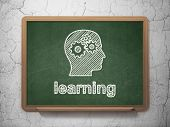 Education concept: Head With Gears and Learning on chalkboard background