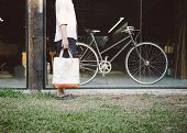 Man With Canvas Bag And Vintage Bicycle On Background