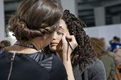 ZAGREB, CROATIA - MARCH 28, 2014: Fashion model prepares in backstage for Couture show by Marina Des