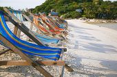 Row Of Sun Beds In The Beach Of Nang Yuan, Thailand
