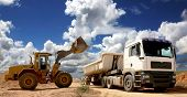 pic of earth-mover  - Front end loader placing stone and sand into a large truck or trailer - JPG