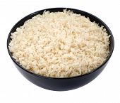 Boiled long grain rice in black bowl close-up isolated