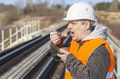 Worker with canned meat on a railway