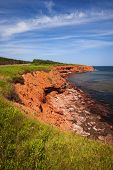 Red cliffs of Prince Edward Island Atlantic coast in Green Gables Shore, PEI, Canada.