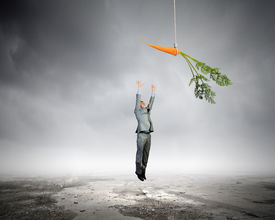 stock photo of dangling a carrot  - Funny image of businessman chased with carrot - JPG