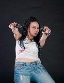 pic of gun shot wound  - white girl shoot handgun with two hands on black background - JPG
