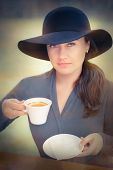 Elegant Young Woman Having Coffee