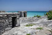 Ancient Mayan Ruin Perched On A Rocky Shoreline